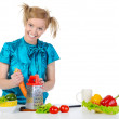 Young girl in the kitchen rubbing carrots. — Stock Photo