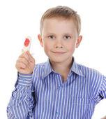 Boy with a bandaged finger. — Stock Photo