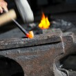 Royalty-Free Stock Photo: Blacksmith forges iron