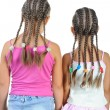 Two girl with pigtails. - Stock Photo