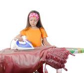 Girl stroking a evening dress iron — Stock Photo