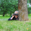 Businessman in the green park - Stock Photo