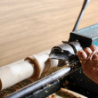Stock Photo: Making wood elements on the lathe