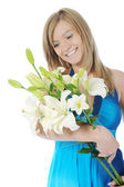 Happy woman with lily in her hand — Stock Photo