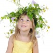 Playful girl with a wreath of flowers. - Stock Photo