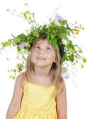 Playful girl with a wreath of flowers. — Stock Photo