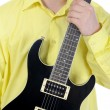 Man with black guitar. — Stock Photo