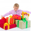Boy with a bunch of gifts — Stock Photo