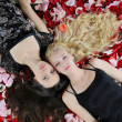 Beautiful women in rose petals — Stock Photo #3780461