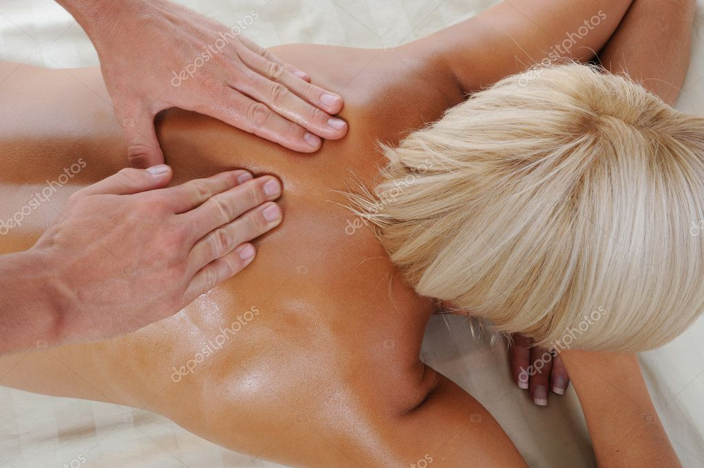 Young tanned woman in the massage procedure — Stock Photo #3819250