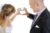 Newlyweds make heart fingers — Stock Photo