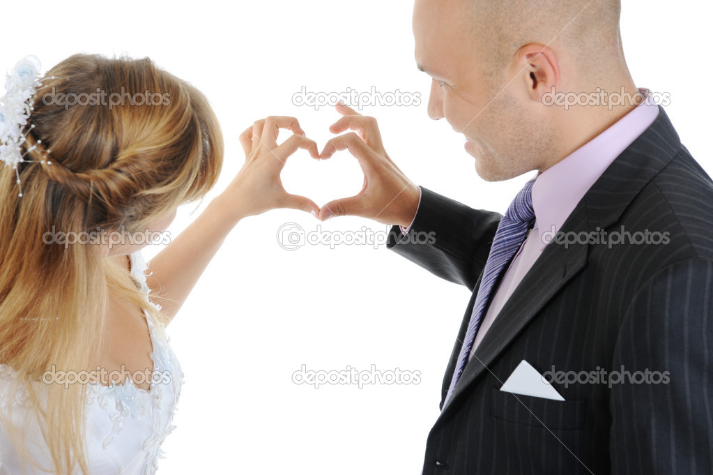 Newlyweds make heart fingers. Isolated on white — Stock Photo #3845227