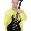 Man with a black guitar. — Stock Photo #3856548