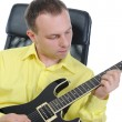 Man with a black guitar. — Stock Photo