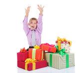 Ragazzo con un mucchio di regali — Foto Stock