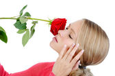 Beautiful blond girl with a red rose — Stock Photo