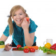 Beautiful smiling girl in the kitchen. — Stock Photo