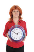 Beautiful girl with a clock in his hand — Stock Photo