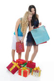 Two women with gifts. — Stock Photo