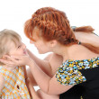 Funny little girl with her mother. — Stock Photo
