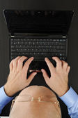 Hands on the laptop keyboard. — Stock Photo