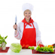 Blond girl cuts the tomatoes in the kitchen — Stock Photo