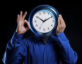 Man holds hours — Stock Photo