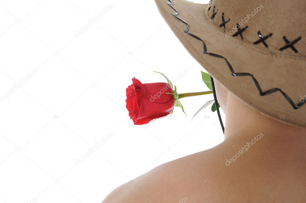 Man in a hat holding a red rose in her teeth. Isolated on white background — Photo #4002274