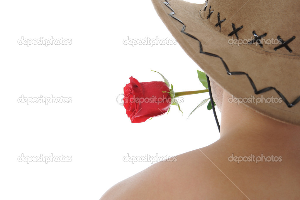 Man in a hat holding a red rose in her teeth. Isolated on white background  Stockfoto #4002274