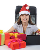 Beautiful young woman in Christmas hat — Stock Photo