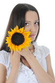 Brunette with a sunflower — Stock Photo