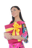 Bruneta s dárkem — Stock fotografie