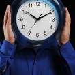 Man holds hours — Stock Photo #4131338