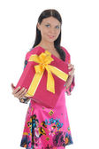 Brunette with a gift — Stockfoto
