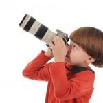 Boy holds a camera — Stock Photo