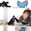 Woman choosing shoes at a store — Stock Photo #4194230