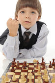 Schoolboy playing chess — Stock Photo