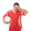 Upset soccer player in the red form. — Stock Photo