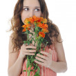 Brunette with a flower — Stock Photo #4299821