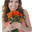 Brunette with a flower — Stock Photo