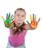 Smiling girl with the palms painted by a paint. — Stock Photo