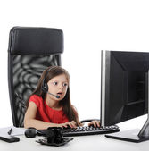 Girl with astonishment looks in the computer — Stock Photo