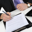 Businessman signs a contract — Stock Photo #4643775