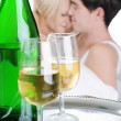 Stock Photo: Young couple drinking champagne in bed