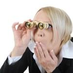 Businesswoman looking through binoculars — Stock Photo
