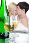 Young couple drinking champagne in bed — Stock Photo