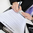 Businessman signs a contract -  