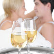 Young couple drinking champagne in bed — Stock Photo #4813069