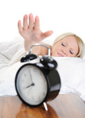 Sleepy woman turns off the alarm — Stock Photo