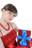 Girl in red with a gift box. — Stock Photo